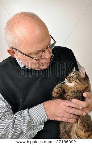 Senior Man With A Cat