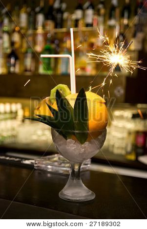 Cocktail with sparks at the bar counter