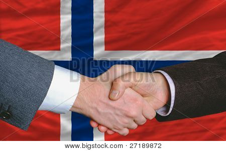 Businessmen Handshake After Good Deal In Front Of Norway Flag