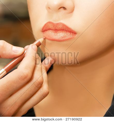 Applying lips contour closeup