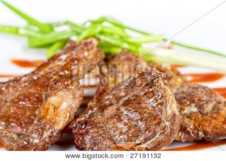 Roasted lamb meat tied with scallion