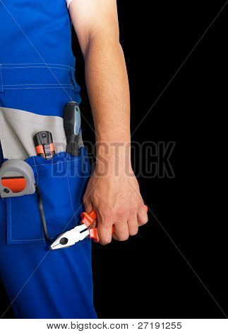 Closeup of repairman with pliers on black background