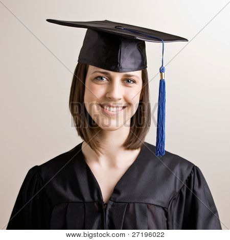 Confident graduating student wearing cap and gown