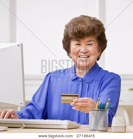 Woman using credit card to shop online conveniently