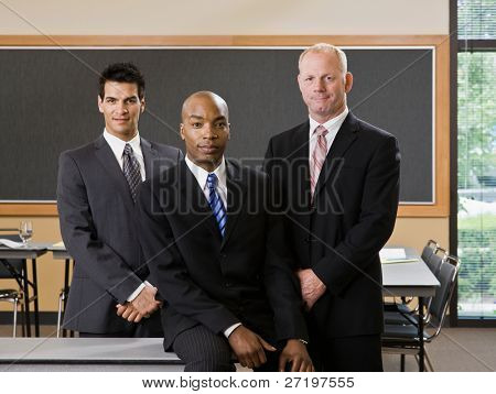 Multi-ethnic male co-workers posing in conference room