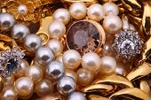 stock photo of chokers  - A mass of shiny golden chains bracelets pearl necklaces and rings - JPG