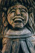 Closeup Portrait Of Hindu Buddhist Traditional Stone Sculpture. Bali, Indonesia poster