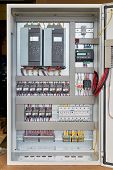Electrical Cabinet With Frequency Converters, Controller, Circuit Breaker. On The Mounting Panel Mou poster