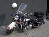 stock photo of chp  - a fancy police motorcycle sits parked on the sidewalk - JPG