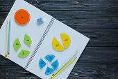 Colorful Math Fractions On Wooden Table. Interesting Math For Kids. Education, Back To School Concep poster