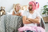 Adorable Happy Daughter Looking At Father In Pink Wig And Tutu Skirt poster