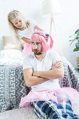 Cute Happy Daughter Playing With Father In Pink Wig And Tutu Skirt poster
