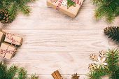 Christmas Background With Fir Tree And Gift Box On Wooden Table. Top View Vintage, Toned With Copy S poster