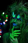 Mystic Green Dryad In Uv Fluor Black Light With Glowing Trees On Background poster