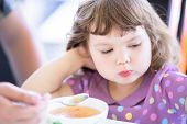 Cute Little Girl Doesnt Want To Eat. Kid Refusing Food. Sad Child poster