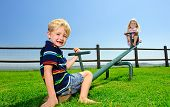 picture of seesaw  - Kids playing at the see - JPG