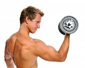 pic of muscle strain  - Handsome muscular man uses his dumbbell to exercise - JPG