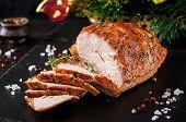 Roasted Sliced Christmas Ham Of Turkey On Dark Rustic Background. Festival Food. poster