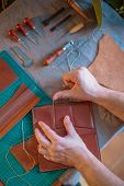 Craft Man Is Working On His Leather Craft, Making Vintage Leather Bag By Leather Work Tool. poster