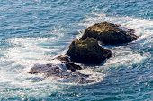 Sea Wave Breaks On Beach Rocks Landscape. Sea Waves Crash And Splash On Rocks. Beach Rock Sea Wave B poster
