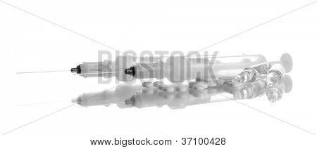 syringes monovet and pills isolated on white