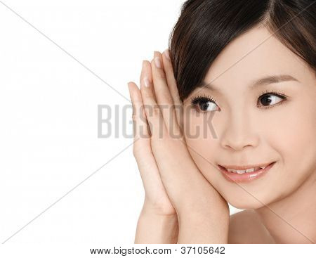 smiling young woman stroking her clean beauty face