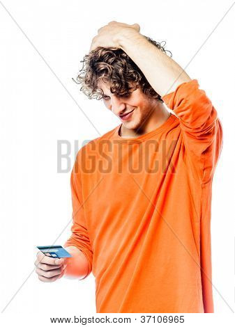 one young man caucasian holding credit card portrait  in studio white background