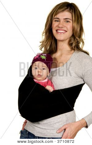 Happy Mama With Baby In A Sling