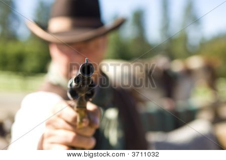 Loaded Gun Aimed At You Focus On Gun Barrel