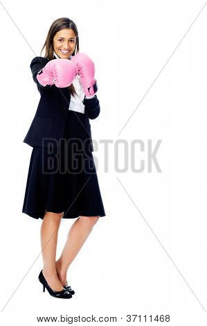 Successful competitive businesswoman is happy and and has boxing gloves while wearing a suit and isolated on white background