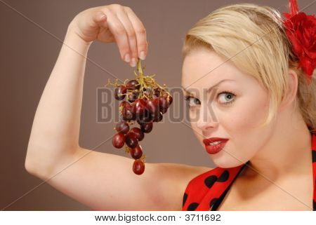 Pretty Girl With Red Grapes