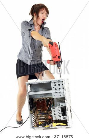 furious business woman piercing computer with electric drill