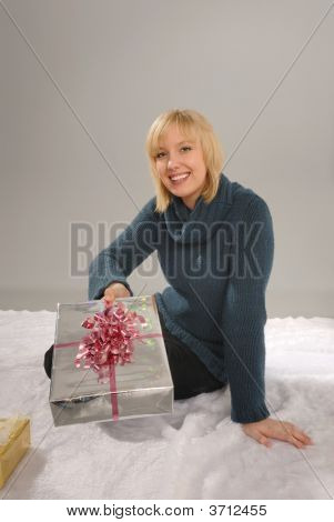 Pretty Blond Offers Christmas Gift