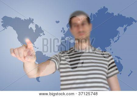 Casual young man touching world map screen