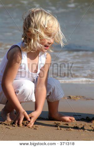 Girl Playing O The Beach