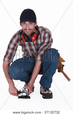 A handyman using a sander