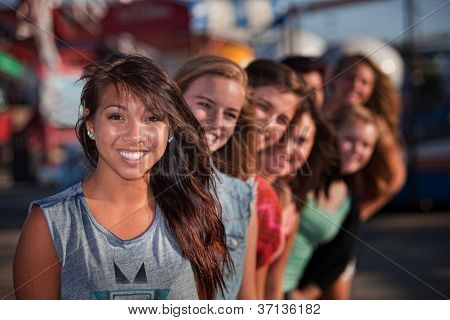 Row Of Cute Girls At Theme Park