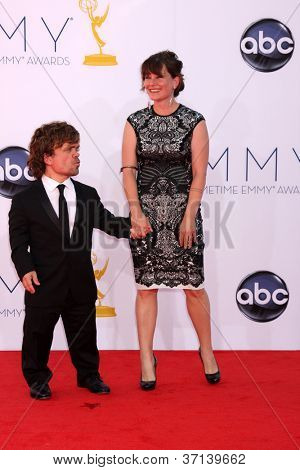 LOS ANGELES - SEP 23:  Peter Dinklage; Erica Schmidt arrives at the 2012 Emmy Awards at Nokia Theater on September 23, 2012 in Los Angeles, CA