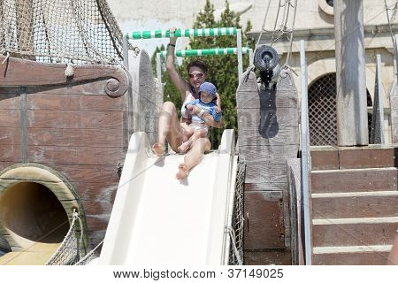 Family On A Waterslide