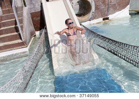 Girl Sliding On Waterslide