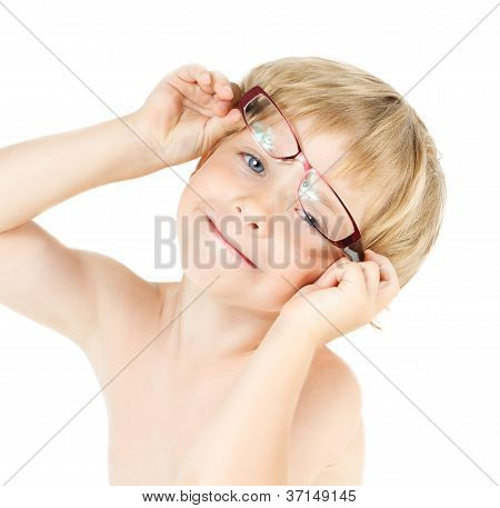 Child Smiling In Eyeglasses. Close Up Funny Portrait