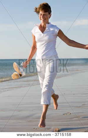 Active Senior At The Beach