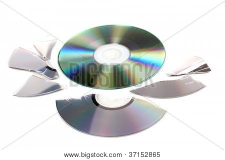 Broken and whole disks with information isolated on white