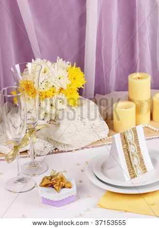 Serving fabulous wedding table in purple and yellow color on white and purple fabric background