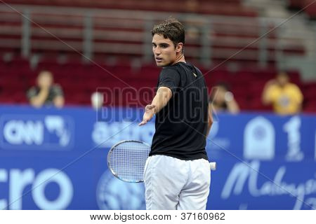 KUALA LUMPUR - SEP 23: Riccardo Ghedin (Italy) appeals to the umpire in his qualifying match of the ATP Tour Malaysian Open 2012 on September 23, 2012 at the Putra Stadium, Kuala Lumpur, Malaysia.