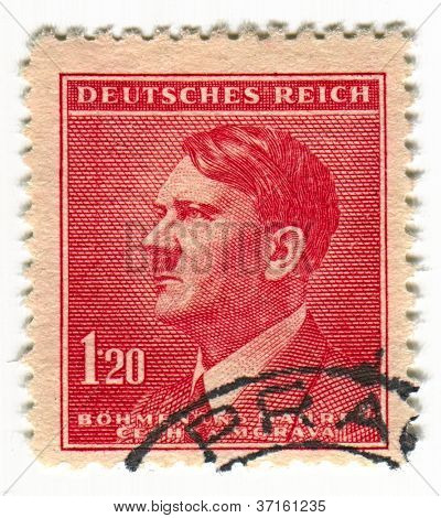 GERMANY - CIRCA 1937: A stamp printed in Germany shows image of Adolf Hitler was an Austrian-born German politician and the leader of the Nazi Party, in red, circa 1937.