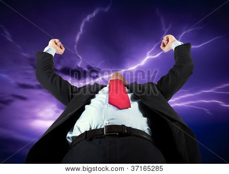 Angry businessman summoning the force of nature