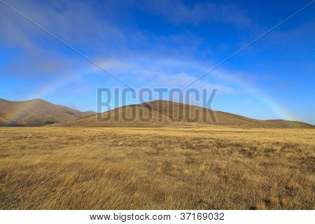 Rainbow Over The Grassland
