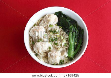 A Bowl Of Noodle And Dumpling Soup