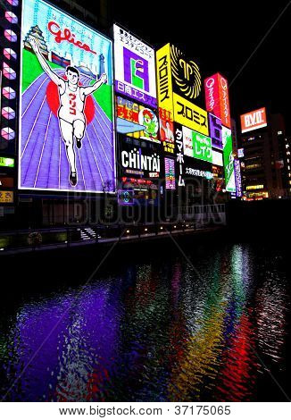OSAKA - DECEMBER 2:Bright neon signs light up Dombotori canal in the Osaka entertainment district. Existing since 1935, Glico Man is one of most recognized neons worldwide. Dec 2, 2008 in Osaka Japan